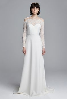 "Brides.com: . ""Jess"" crepe wedding dress with Chantilly lace scallop detailing on sleeves and low back, Christos"