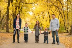 T.C. MARTINSEN Photography: ANDERSEN || family fall family portrait session in yellow fall leaves. family of five with young kids in Utah location standing in trees and on path poses