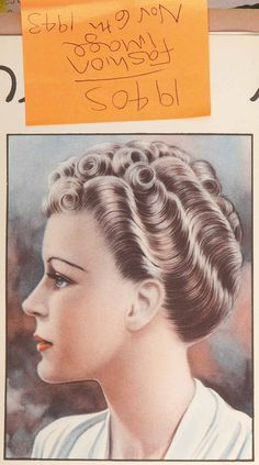 Vintage women's hairstyle from HJ, dating back to the 1940s.
