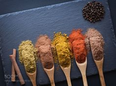 http://500px.com/photo/188163711 colorful herbs and spices by fotomans -colorful herbs and spices in wooden spoons on black stone background  top view.. Tags: yellowredconceptcolorbackgroundbrowncloseupnaturalblackfoodkitchengroundspacecolorfulherbsasianwoodentablerusticgroupdrypowdercookingcinnamonspicenutmegcuisinearomaaromaticflavorcondimentingredientpaprikatop viewspicessaffronspoonsgrainsvariouscurrycorianderseasoningheapturmericscatteredstone board