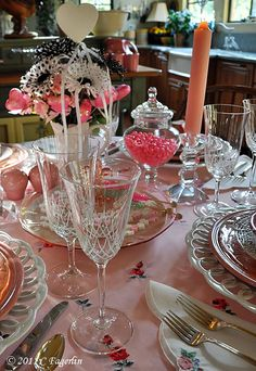 Valentine's Table - Ok I love this because not only is it PINK but it is also easy to do with your existing treasures. The color comes from candy, candles, and a very special pink tablecloth!