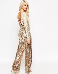 This **Naeem Khan** jumpsuit features a V-neckline, flared legs ...