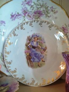 Big one is Haviland Limoges, small one with the lady is German.