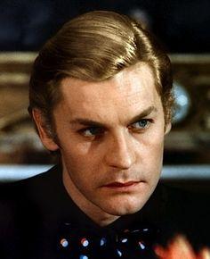 Helmut Berger as Sir Graham Reid Malett (The Lymond Chronicles)
