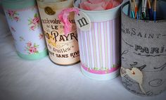 Cans decorated with paper!  Adorable.