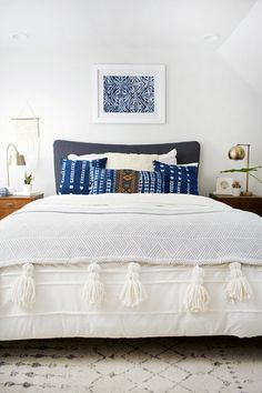 a possible look for your bedroom:  frame a treasured fabric, scarf, tea towel, doily and add throw pillows in same colors, add a textured throw Indigo Bedroom, Ethnic Bedroom, Modern Bohemian Bedrooms, Blue Bedroom, Bedroom Colors, Blue White Bedrooms, Bohemian Bedroom Decor, Blue And White Comforter, Modern Bedroom