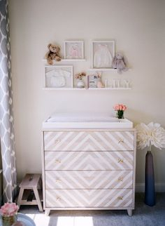Land of Nod cream and gold dresser: http://www.stylemepretty.com/living/2016/12/02/a-blushing-baby-nursery-as-pretty-as-they-come/ Photography: Audra Wrisley - http://audrawrisley.com/
