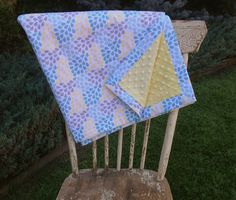 "Super cute ""Little Ark"" fabric by Riley Blake and banana dimple dot minky.  Lightweight and yummy blanket."