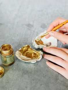 Seashells + gold leaf = the prettiest catchall for jewelry & knick knacks #DIY