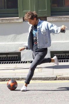 Louis playing football with the rest of one direction, 29th August.