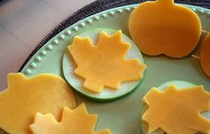 Thin slices of cheese cut out with cookie cutters for shapes. I absolutely love this. I bet it makes the cheese taste better. Haha.