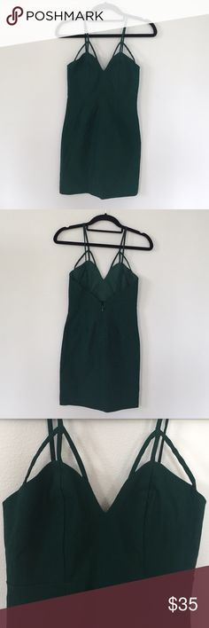 """Nasty Gal Green """"Major Points"""" Dress Super cute hunter green Nasty Gal dress. Features super cute cut out straps and a discreet zipper down the back. Size XS and definitely fits like one. Never been worn but tags have been removed. Rayon, Nylon, and Spandex mix material with a bit of a stretch. I love this dress but it was a tiny bit short on me. Tight fitting and perfect for a night out  Nasty Gal Dresses Mini"""
