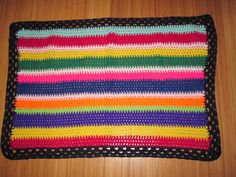 Multi colour stripe baby blanket hand crochet available at www.woollygoods.com