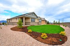 A beautifully landscaped new home built by Vantage Homes. The Flying Horse community. Colorado Springs, CO.