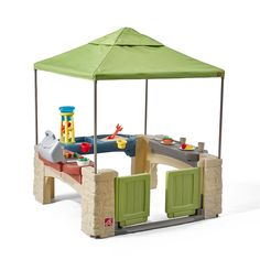 "Kiddos can hold their own backyard party with the All Around Playtime Patio with Canopy by Step2. Little ones will be able to entertain for hours with the pretend play kitchen grill, and cook up their favorite grub just like Mom and Dad. Youngsters will enjoy the wait for ""dinner"" while playing with the attached sand and water play table. Once dinner is ready, children can eat at the snack table with the included dish set to complete the ultimate game of ""restaurant."" Thi..."