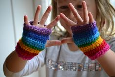 Child's rainbow fingerless mitts (matches the rainbow scarf) Crochet Girls, Crochet For Kids, Crochet Gloves, Crochet Scarves, Crochet Gratis, Fingerless Mitts, Wrist Warmers, Hand Warmers, Easy Crochet Patterns