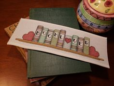 """Book Lover"" counted cross-stitch pattern by Rogue Stitchery. Cross Stitch Books, Cross Stitch Bookmarks, Cross Stitch Needles, Counted Cross Stitch Patterns, Cross Stitch Designs, Cross Stitch Embroidery, Embroidery Patterns, Hand Embroidery, Book Markers"