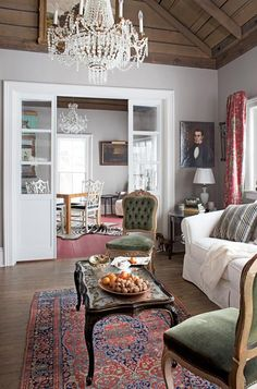 Love this mix: a Crate and Barrel sofa with 19th century antiques #livingroom #decorating