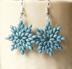 These beautiful earrings are handmade with opaque blue luster SuperDuo Czech seed beads, Japanese seed beads and silver plated earring hooks. The earrings come with clear rubber earnuts.  Each earring