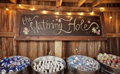 """""""watering hole"""" with beverages in galvanized buckets"""