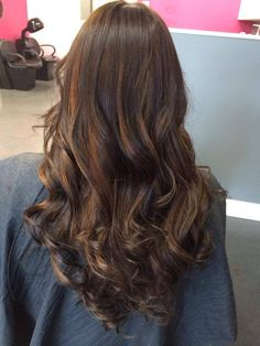 Long, layered cut with natural light brown highlights. Perfect for low maintenance brunettes!