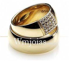 Aliança de noivado e casamento Aliança em ouro amarelo 18k 750 Peso: 20 gramas o par Pedras: 25 diamantes de 1 ponto Largura: 8 mm ANATÔMICO BAIXO ACABAMENTO:LISO ALTURA:1MM