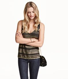 Camisole top in jersey with a low-cut V-neck at front and back, narrow shoulder straps, and short slits at sides. Slightly longer at back.