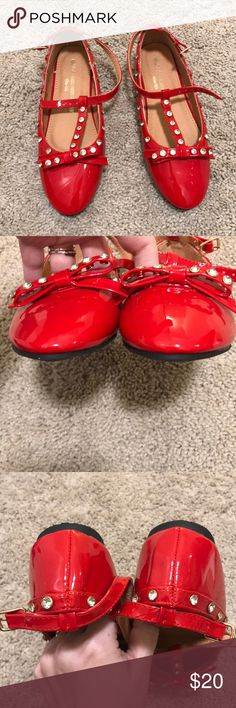 NWOB Red jeweled ankle strap faux patent flats Red jeweled flats. These feature a bow at the toe and an ankle strap. They are made from faux patent leather. Girls size 4. New without box, never worn. Made by Versace 19.69 Abbigliamento Sportivo SRL Milano Italy. Versace Shoes Dress Shoes