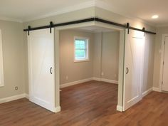 Created a versatile space in an open room with barn doors - Haus und Garten - Basement Bedrooms Basement Makeover, Basement Renovations, Home Renovation, Home Remodeling, Basement Storage, Closet Storage, Small Basement Remodel, Bedroom Storage, Closet Organization