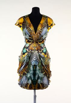 Plato's Atlantis dress by Alexander McQueen, Spring/Summer 2010. Design features digitally printed textile with layered photo images of reptile skins.