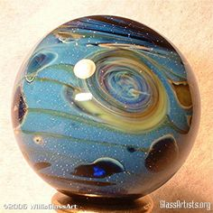 Glass Marbles - Glass Artists.org. ( I love footed paperweights).