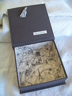 Fabric covered box - use old city maps to cover inside. love using maps! would look great on the outside too. the tassel on the outside would make a great gift for graduates
