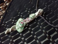 Lily Twist Handcrafted Polymer Clay Pendant with Acrylic Wash. $18.00, via Etsy.