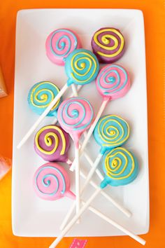 Decorate cake pops with swirls in contrasting colors.