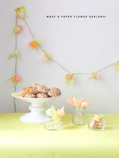 DIY Crepe Paper Flower Garland, via Oh Happy Day from August 26, 2011.  Would be a cute and inexpensive decoration for a wedding shower or engagement party.