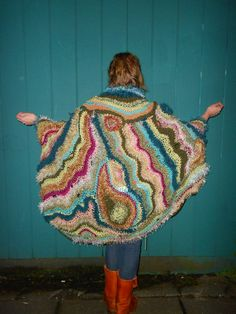 Beautiful! One of a kind, free form crochet, caped shawl.  L/XL - yarns: bamboo, cotton, acrylic, silk, synthetic, netting, wool. $649