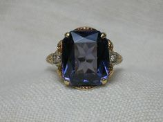Art Deco Alexandrite Ring: Rose Gold & Diamond Stunner. $490.00, via Etsy.