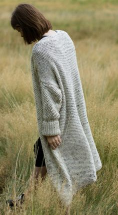 Knitting Pattern for Easy Banff Cardigan - Oversized long sweater knit in seed stitch with worsted weight yarn on large needles. The designer The Blue Mouse says this is an easy pattern that requires basic knowledge of stitches and seaming. Length is customizable.
