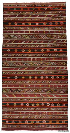 Vintage Turkish kilim rug embroidered with jijims. This striped rug was hand-woven around 40 years ago in Sivas, in the Central Anatolian region of Turkey and it is in very good condition.