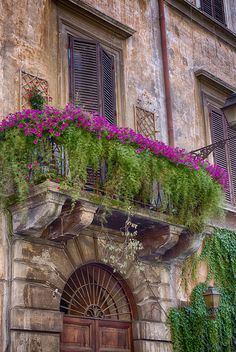 Beautiful window with balcony in Rome