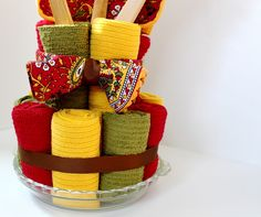 The Cottage Home: Dish Towel Cake ~ A Bridal Shower Gift: Solid color dish towels, an elastic hair-tie to hold in place, pie dish for base, small cardboard round box in middle and  wooden spoons, cookbook and ramekins.