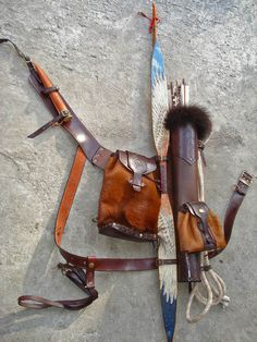 Multifunctional Tooled Leather Quiver Holding a Bow, an Axe, a Knife and a Rope with a Detachable Pouch and Detachable Backpack
