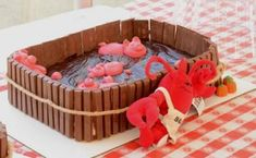 pigs in mud chocolate cake - a great addition to a pig roast themed party.  learn how to make this cake.