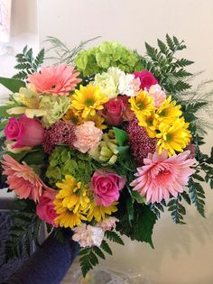 A blooming blush posy, filled with gerberas, mums, rice flowers, roses, alstros, hydrangeas.