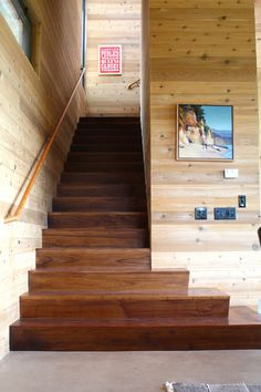 staircase by Shannon Malone - Cedar wood paneling lines the interior walls and ceilings. Walnut was used on the stairs. A Contemporary Camp Style - rusty, simplistic yet inviting house in the mountains of Aptos, just south of the surfing community of Santa Cruz in California.