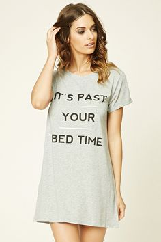 "A knit nightdress featuring a front ""It's Past Your Bed Time"" graphic, a round neckline, and cuffed short sleeves."