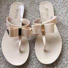 Nude Michael Kors flip flops Nude flip flops with gold details. Brand new. Comes with the original box. The box says size 6 but they are actually a size 5.5. Michael Kors Shoes Sandals