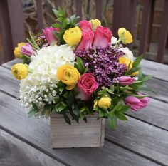Flower gift in a wooden box.
