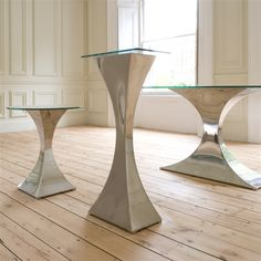 Tom Faulkner - Capricorn Pedestal    This beautiful pedestal is a sculptural and contemporary with classical lines. It is available in any of our standard finishes and in mirror polished stainless steel.