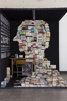 Numabookface- face shaped book shelf - part installation, part bookstore, made of 3500 used books that fall under the keyword 'fantasy'